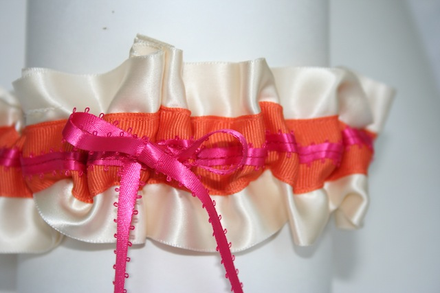 orange grosgrain stripe and a hot pink feathered satin bow 2 inches
