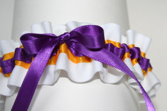 louisiana state university themed white purple and gold wedding garter