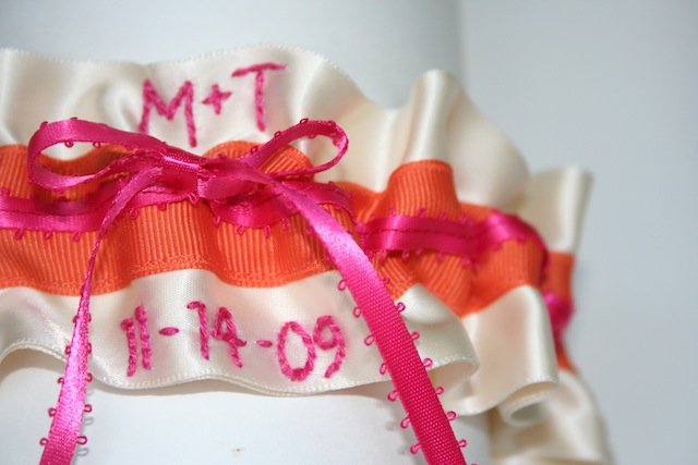 here is an orange and hot pink wedding garter that i recently designed