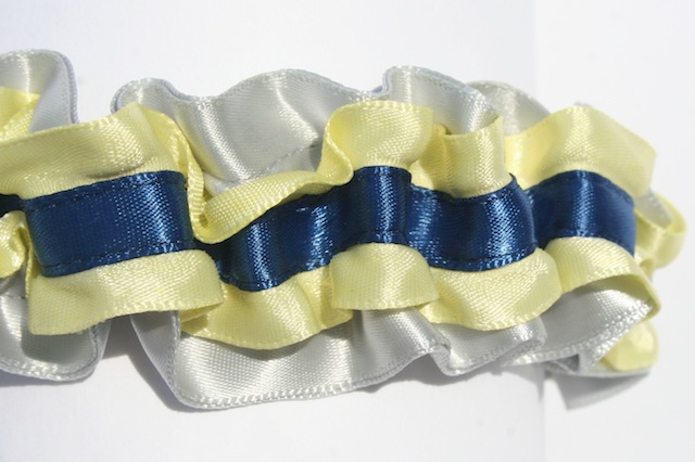 this custom wedding garter is sliver satin with yellow ruffled edge satin