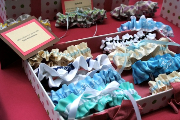 embroidered wedding garters on display at wedding show - julianne smith