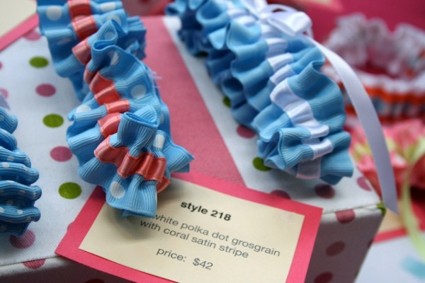 something blue wedding garters on display at wedding show - julianne smith