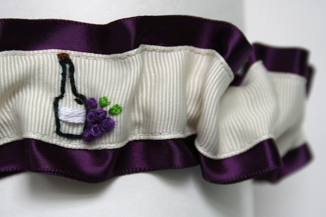 wine themed hand embroidered deep purple and ivory wedding garter by the